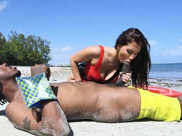Sexy lifeguard Valerie Kay helps a man with her blowing skills