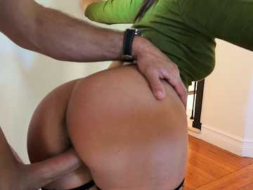 Brunette in green blouse and black fishnets Abella Danger is facialized by long penis