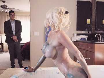 Nicolette Shea makes interview go her way with a blowjob in the bathroom