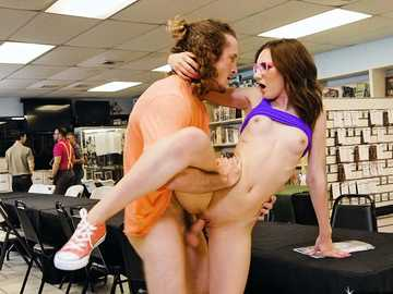 Petite Kelsey Kage is acting like a slut in a book store and receives a cock