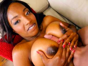 Busty black girl Daya Knight puts her talent to work in titty fucking scene