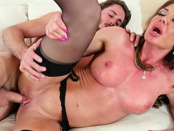 Hardcore MILF Nina Dolci sedues her son's friend for pussy fucking on couch