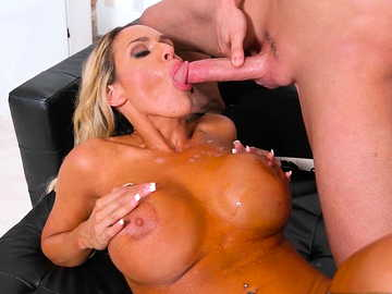 Curvaceous milf with large fake boobs Tegan James gets fucked by Tyler on black couch