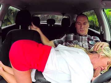 Cuddly female Tylo Duran rubs the driver's dick while he touches her legs